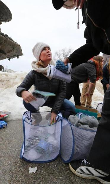 COPE volunteers from Hingham, including Amy Torrey, handed out clothing on Boston Common.